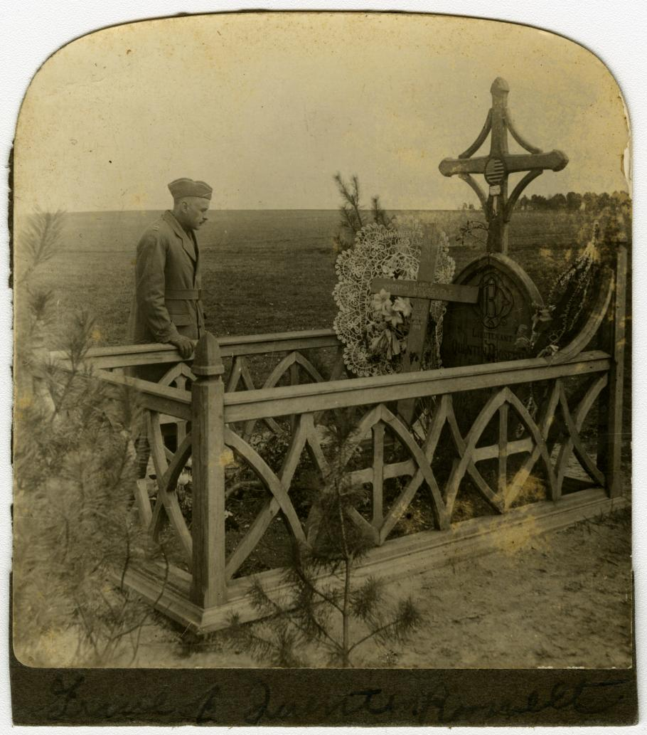 Soldier standing by grave of Quentin Roosevelt