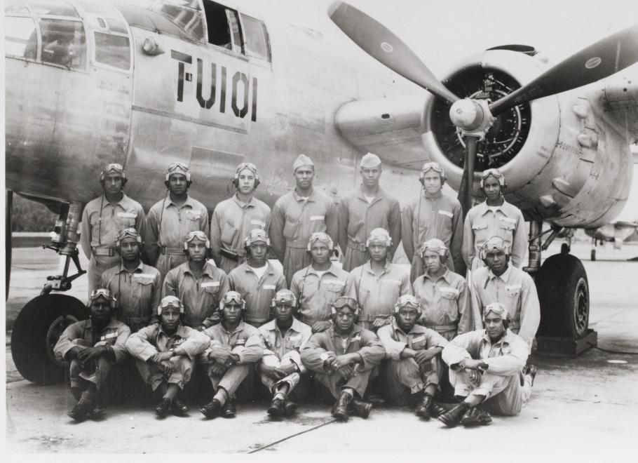Group of airmen in front of aircraft