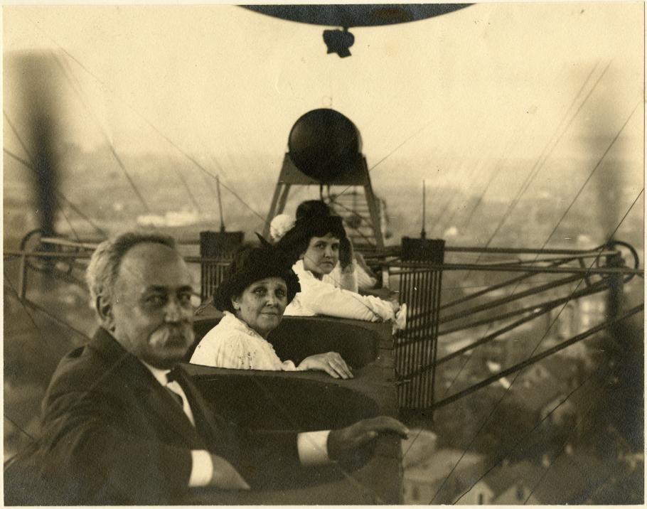 Three people sit in an airship