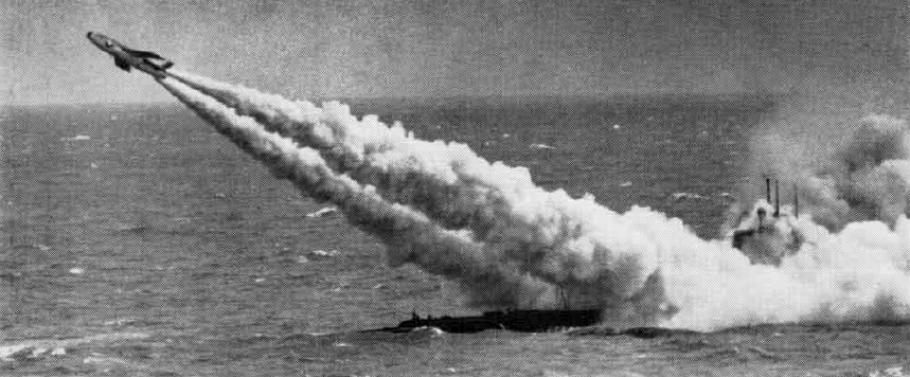 Grainy, black and white photo of a missile taking off a submarine.