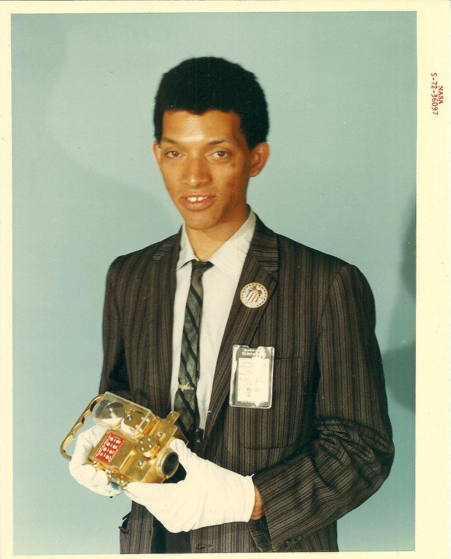 Carruthers holding film cassettes