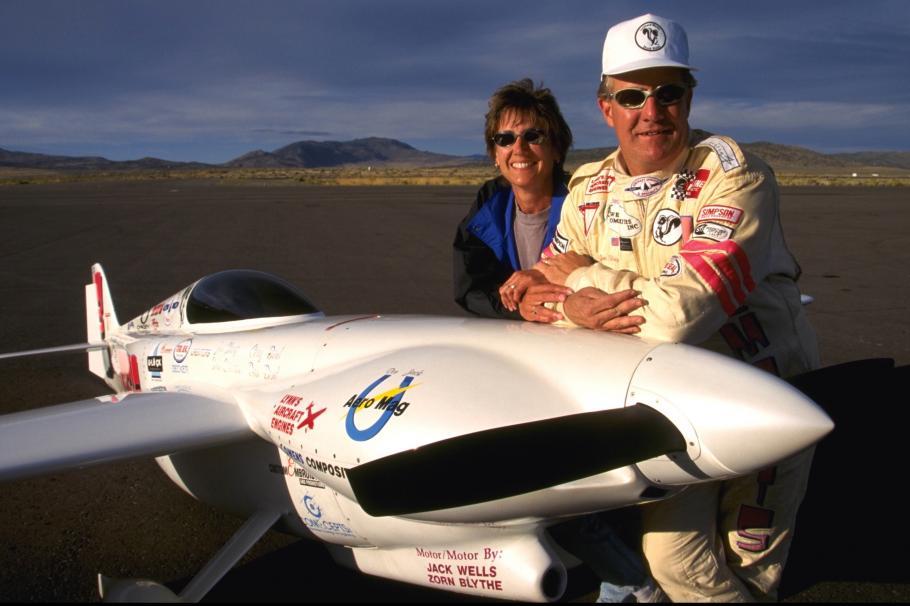 Jon and Patricia Sharp stand next to their plane, Nemesis.