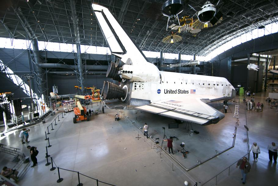 Discovery in space hangar surrounded by digitization equipment