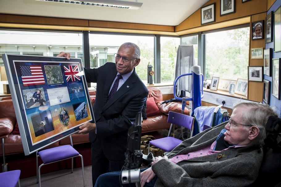 NASA Administrator Charles Bolden presents a commemorative NASA montage to Professor Stephen Hawking