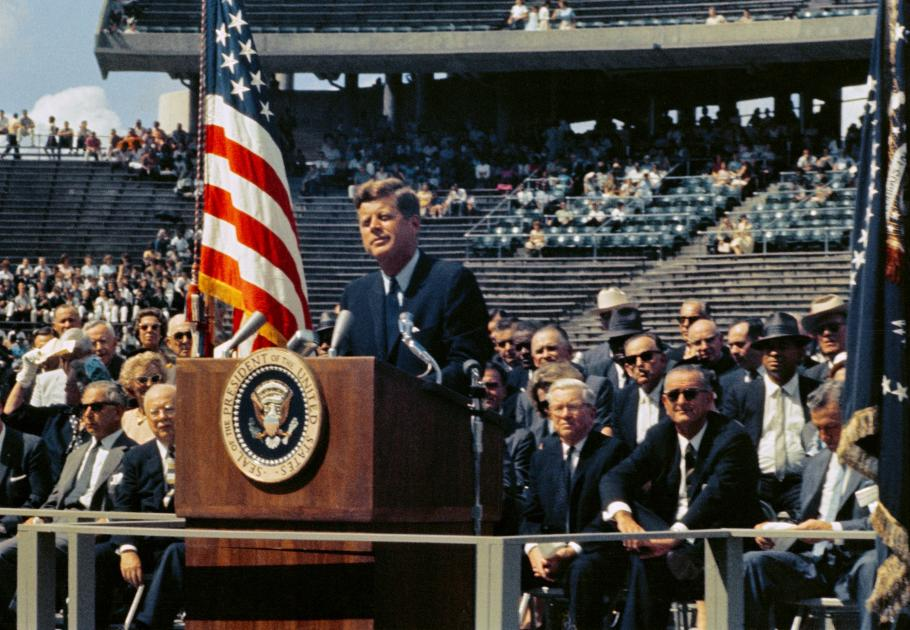president standing behind podium
