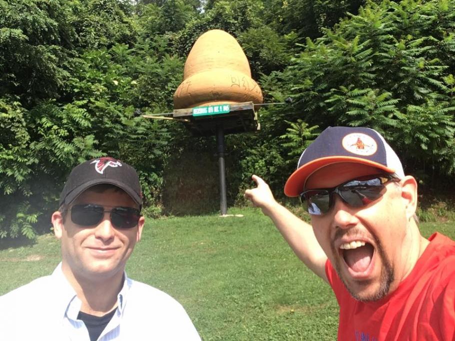 Selfie in front of roadside attraction.