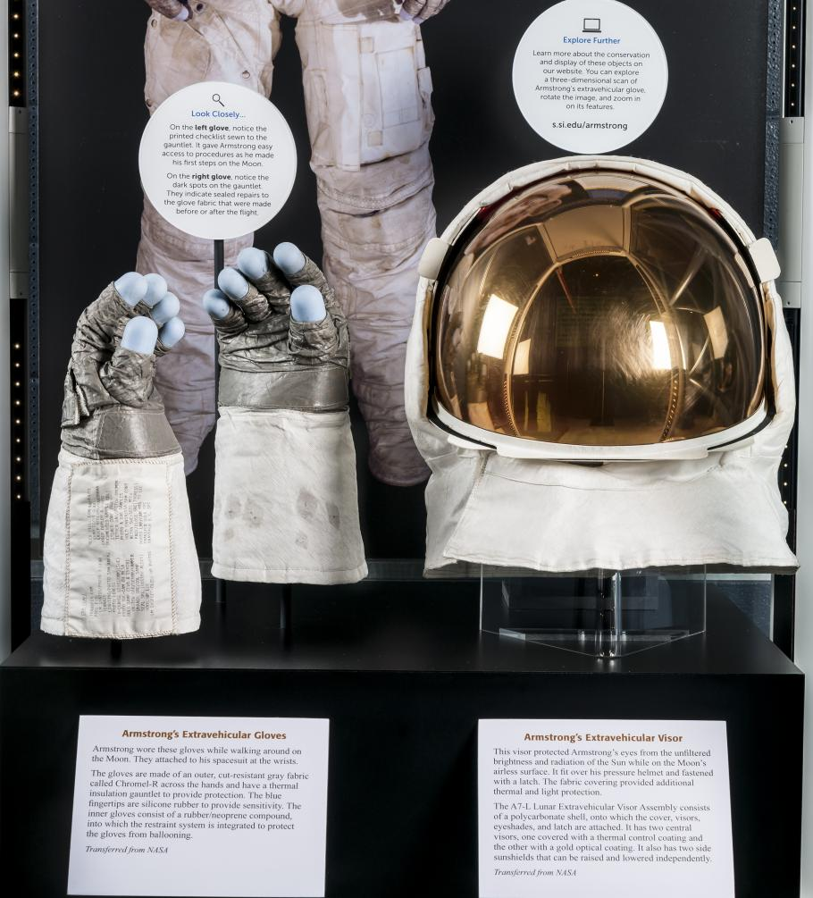 Close up view of Neil Armstrong's gloves and helmet from the Apollo 11 mission