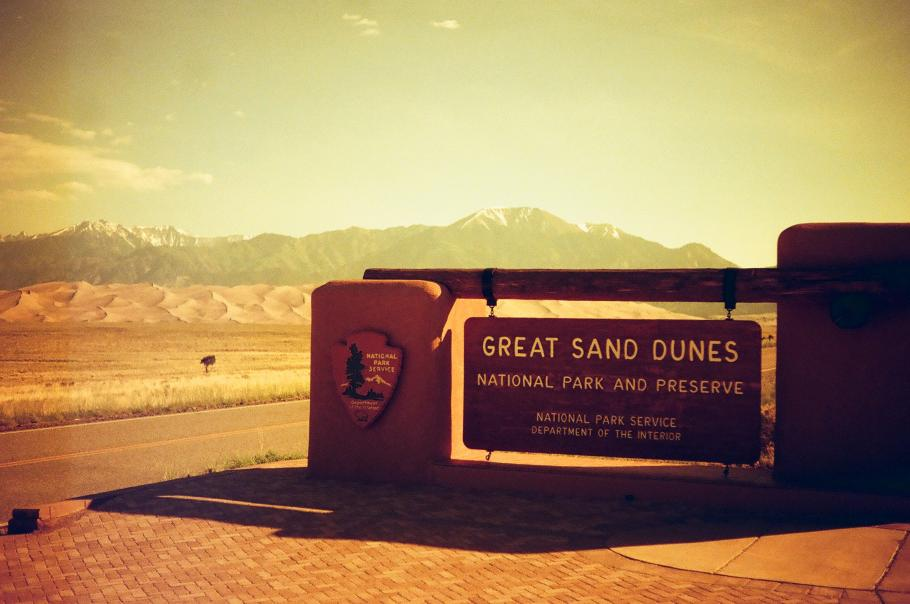 Filtered image of the welcome sign for the Great Sand Dunes.