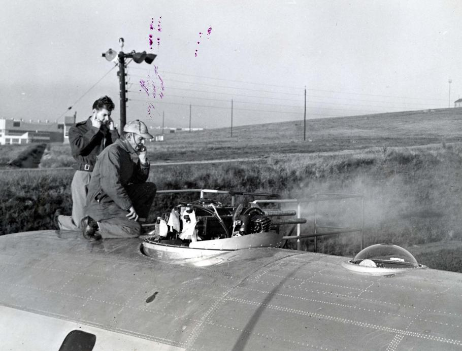 Two men on top of aircraft