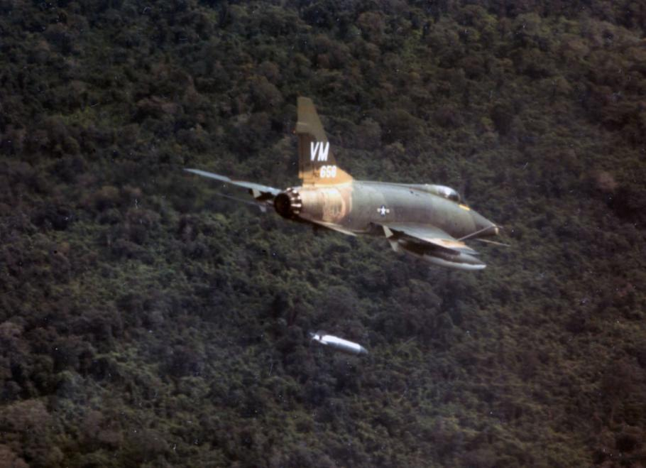 A F-100D aircraft of the 352nd Tactical Fighter Squadron dropping a napalm bomb near Bien Hoa, South Vietnam.