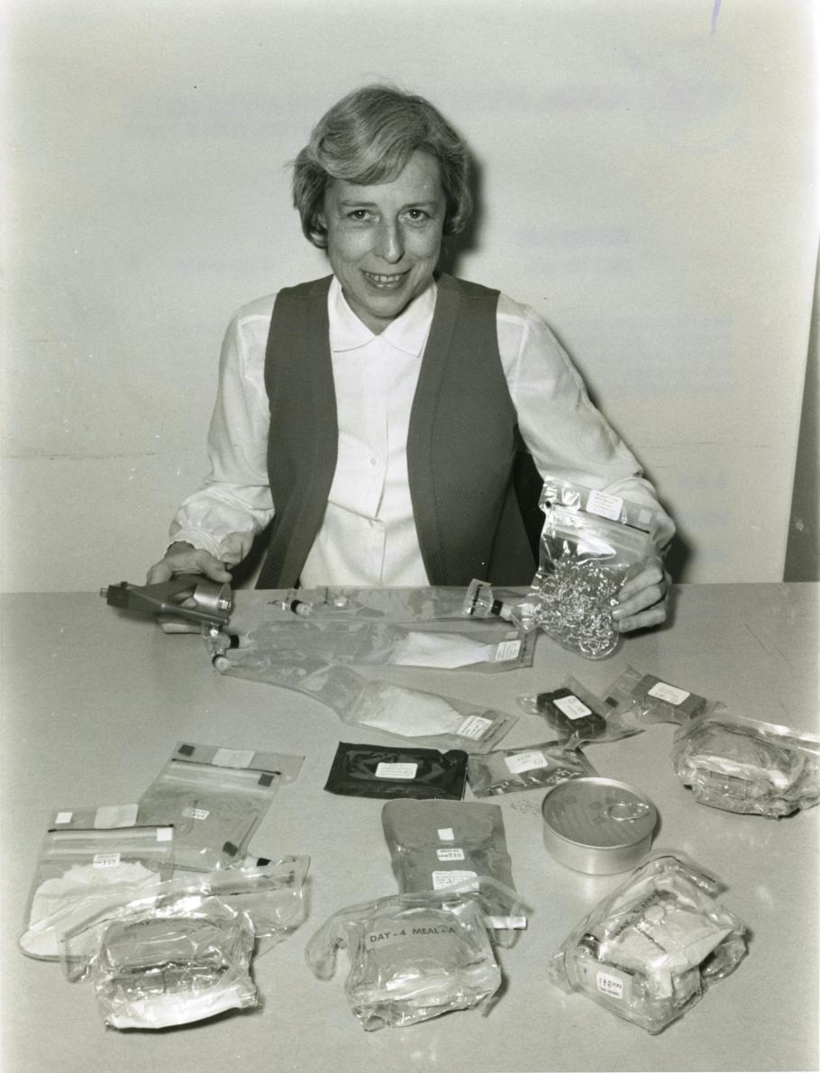 Rita Rapp displays the range of food containers used on the Apollo 16 mission