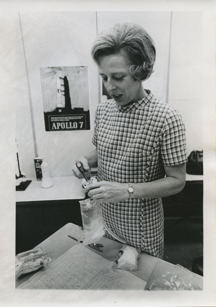 Rita Rapp carefully stows a bag of frankfurters besides labeled meal packages.