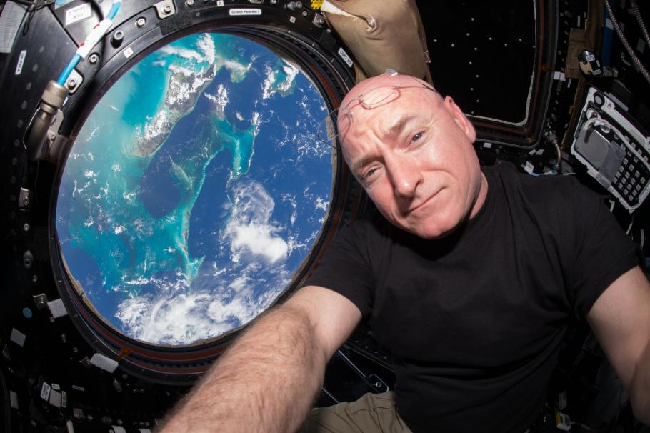 A photograph of Kelly with a view of the Earth in the background.