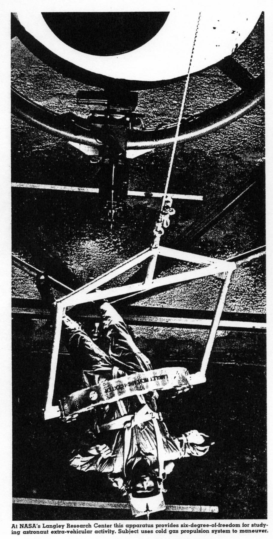 Man hangs upside down in a weightless simulator.