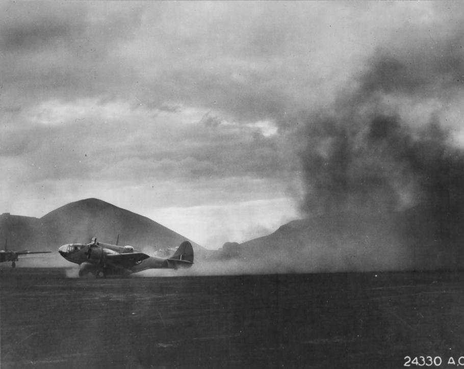A U.S.-built Martin 167 kicks up dust during takeoff on Ascension Island