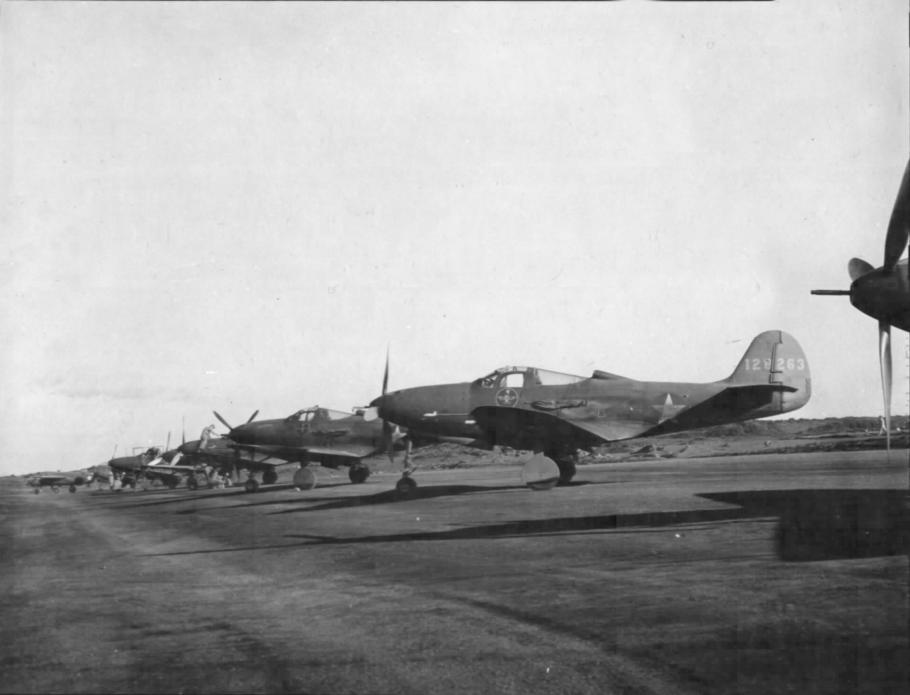 Bell P-39 Airacobras passing through Wideawake Field