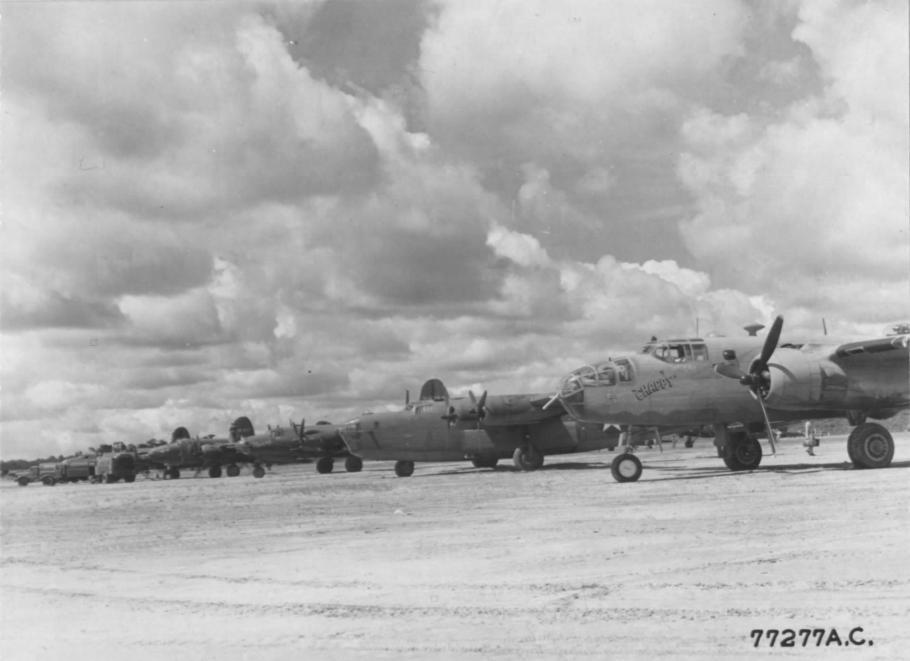 B-24s, B-25s, and B-26s sit on the ramp at Val De Case Airfield