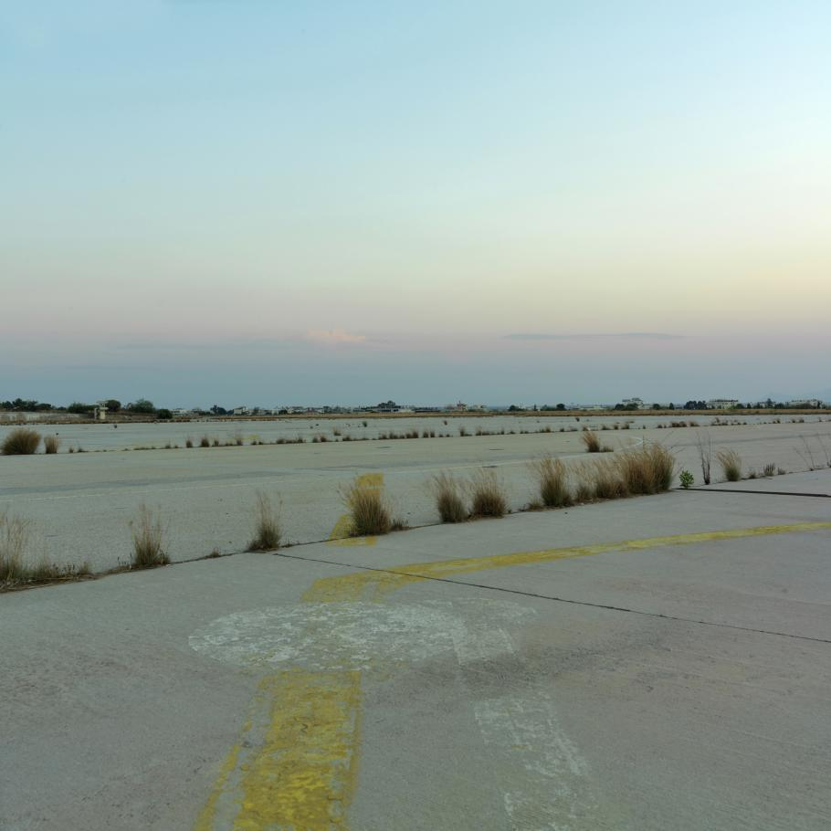 Grass grows through the cracks of the ruwnay at the Ellinikon International Airport runway in Athens, Greece, which closed in 2001. This photo of the now-defunct airport was taken in 2007.