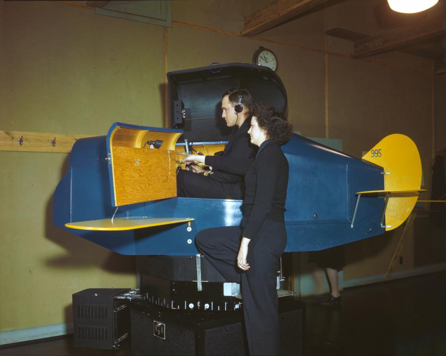 A WAVES Link Trainer instructor gives pointers to an officer