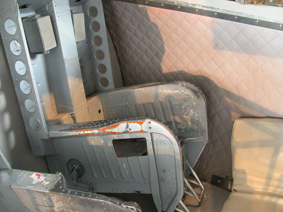Side view of metal, gray seat.