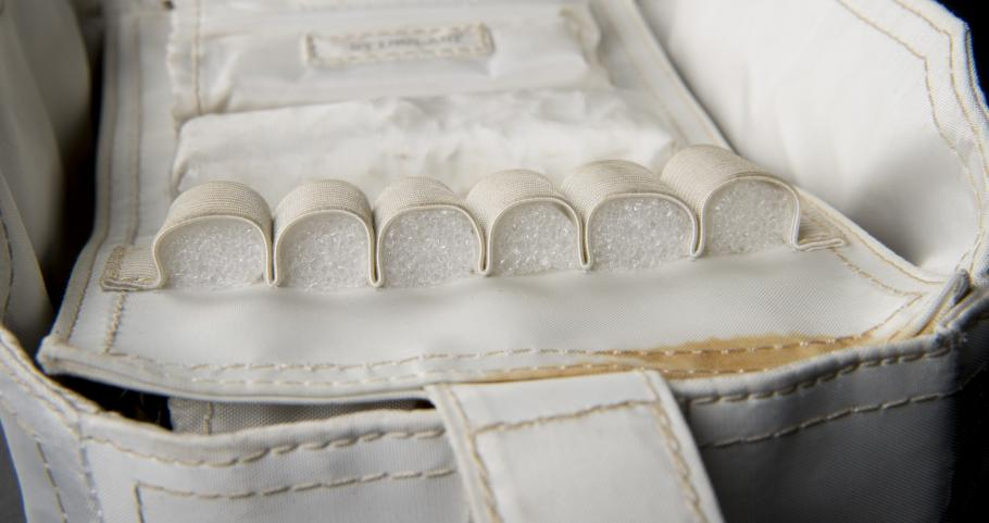 View of archival foam inserts placed in voided compartments within the medical accessory kit.