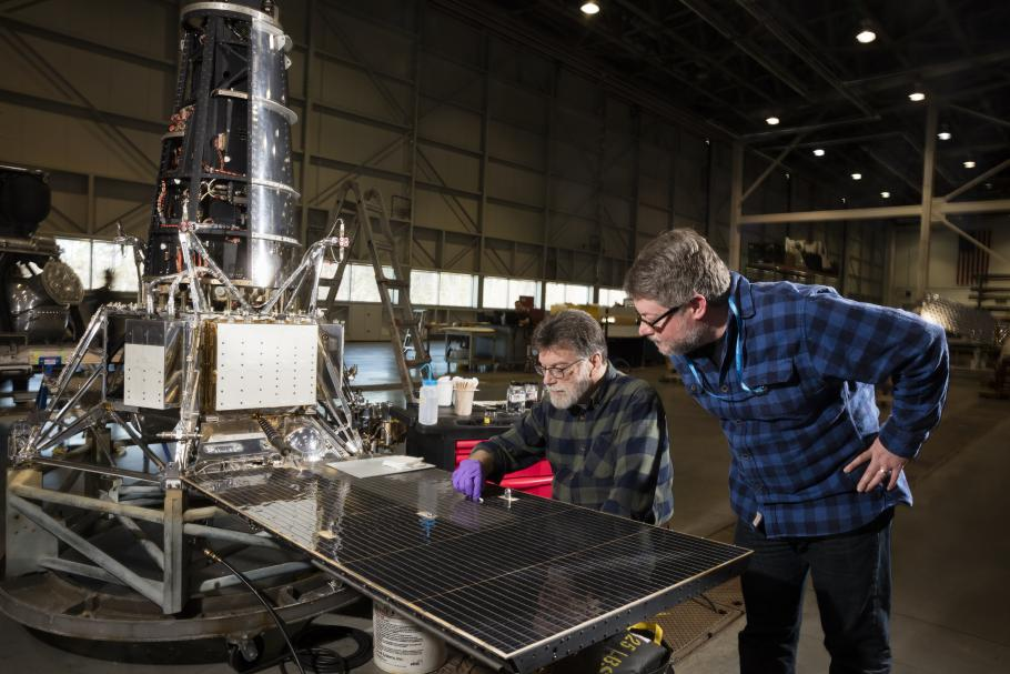 Museum conservator David Blanchfield and space history curator Matt Shindell examining the Ranger 7 spacecraft