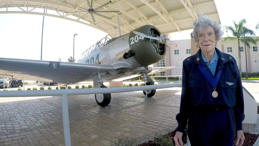 Bernice Haydu, stands next to an AT-6 Texan in 2016