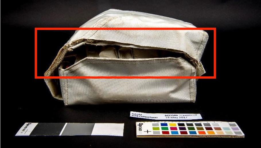 Before conservation, a section of the container's lid is missing on the left side of the medical kit (indicated in red).
