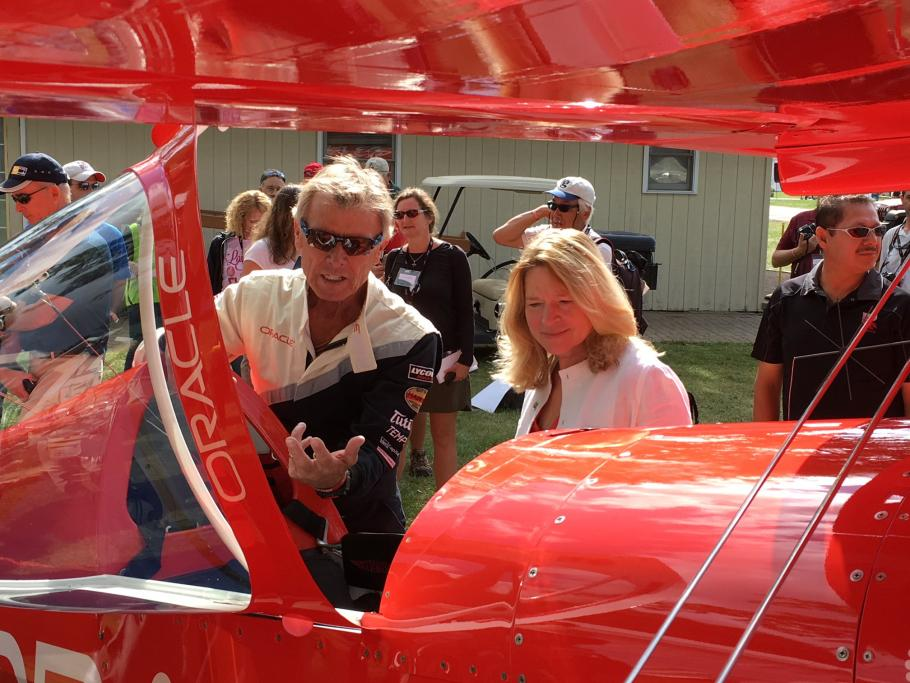 Dr. Ellen Stofan with Aviator Sean D. Tucker and his Oracle Challenger III biplane.