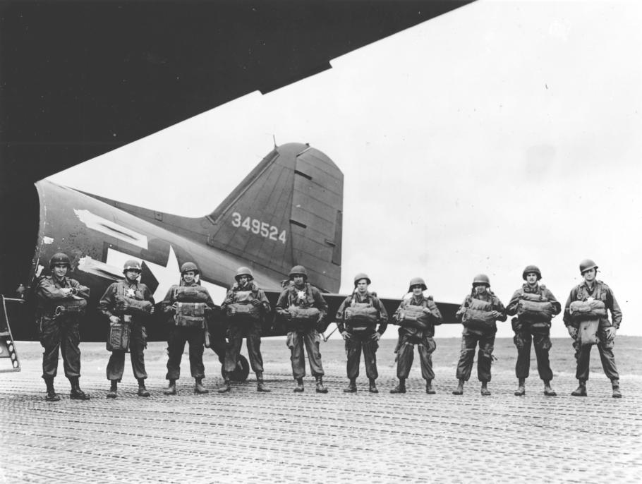 row of men men standing in front of an aircraft