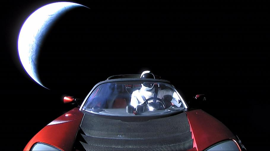 red car with mannequin in space