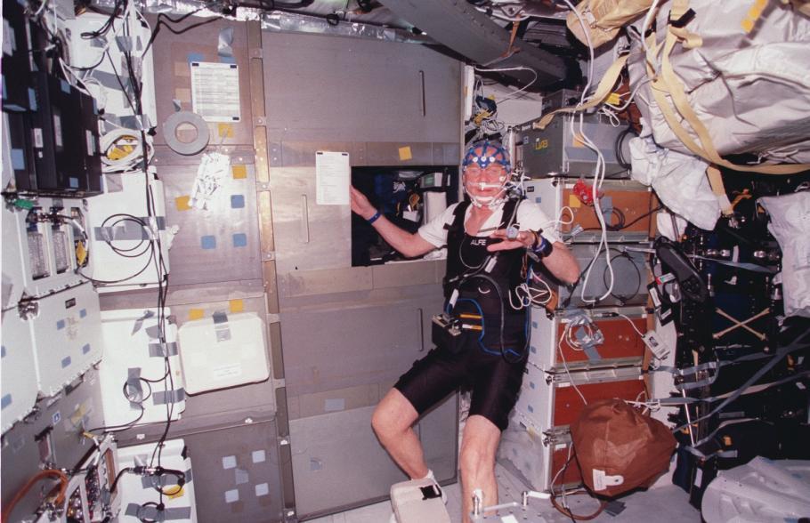 John Glenn on STS-95 wearing experiment sensors and other equipment.