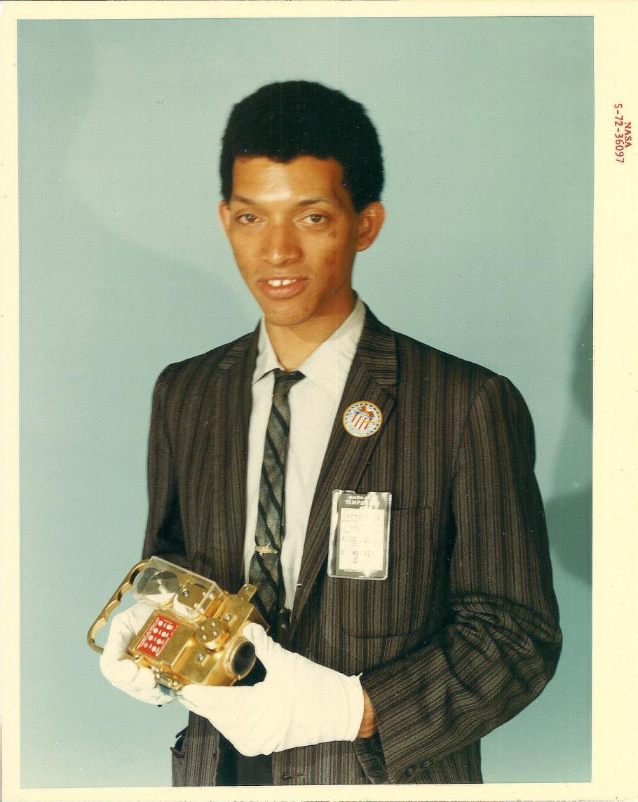 Portrait of Carruthers holding film transport.