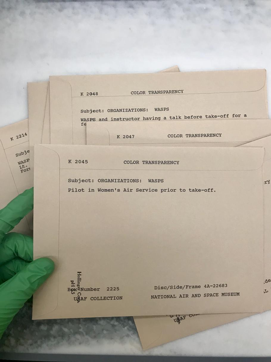 WASP Images in Archival Storage. Each transparency contains a sleeve with identifying information and accompanying caption.