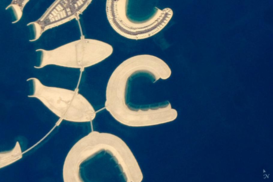 An astronaut captured this photograph of an artificial island at the southern end of Bahrain Island on January 23, 2011. The island appears in the shape of the letter C.