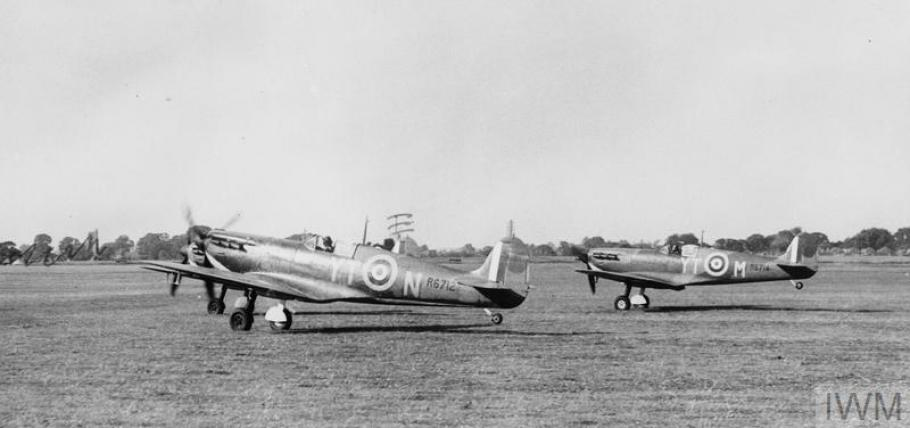 Two spitfires taking off