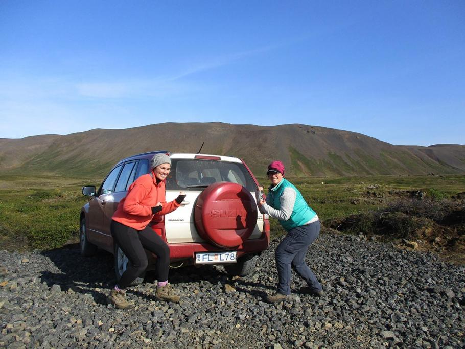CEPS scientists next to their field vehicle.