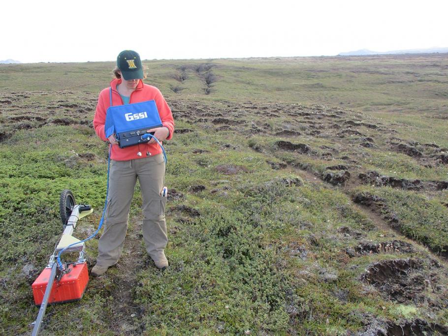 The author using a ground penetrating radar system to image the location of the soil-bedrock boundary.