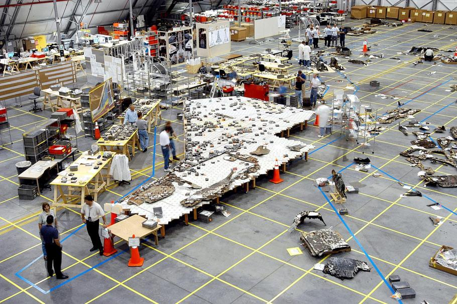 In Kennedy Space Center's Reusable Launch Vehicle hangar, investigators placed recovered fragments of the underside of Columbia's left wing onto a table that showed their relative position on the wing.