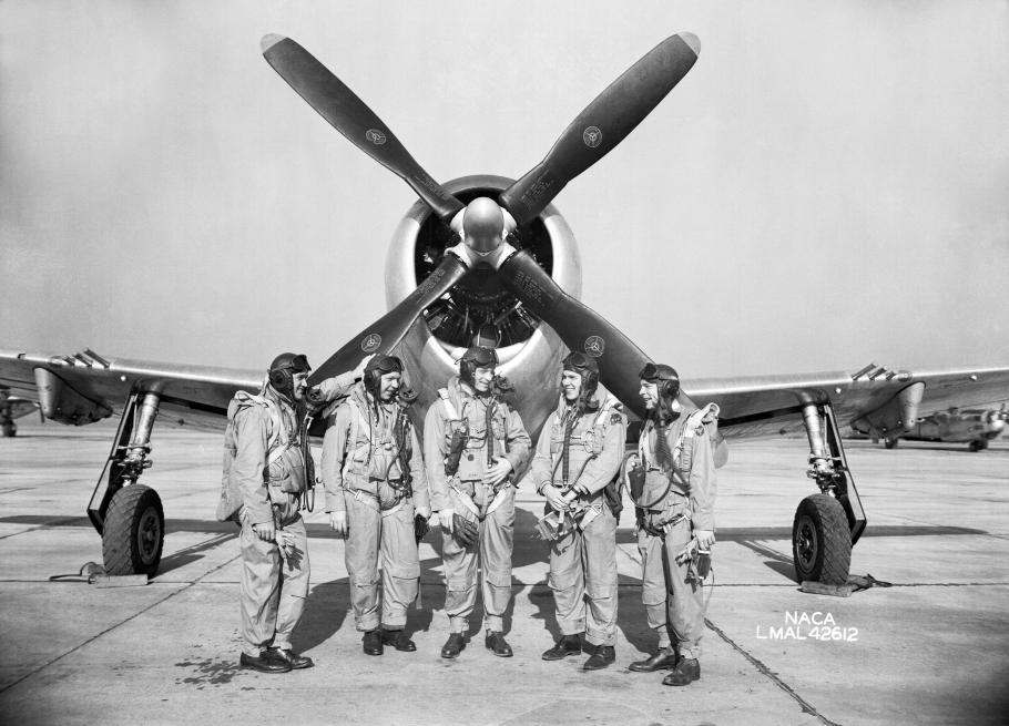 In 1945, test pilots Mel Gough, Herb Hoover, Jack Reeder, Steve Cavallo, and Bill Gray stand in front of a P-47 Thunderbolt.