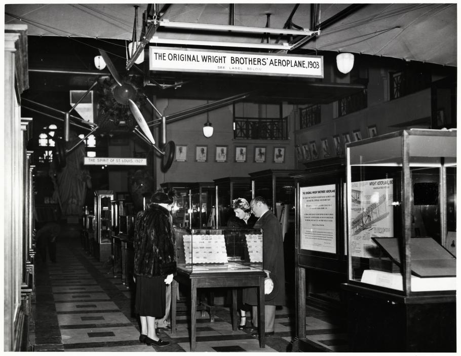 Visitors look at exhibit