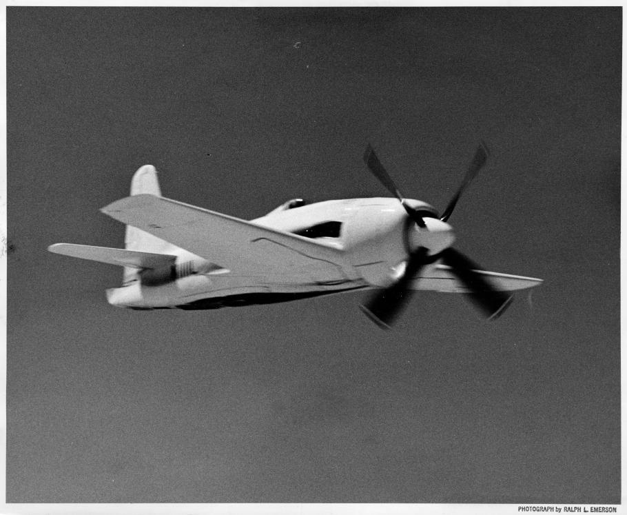 Greenamyer's Conquest I in flight, seen flying upside down.