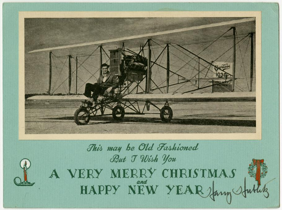 Christmas Card with photo of a man flying a Curtiss aircraft