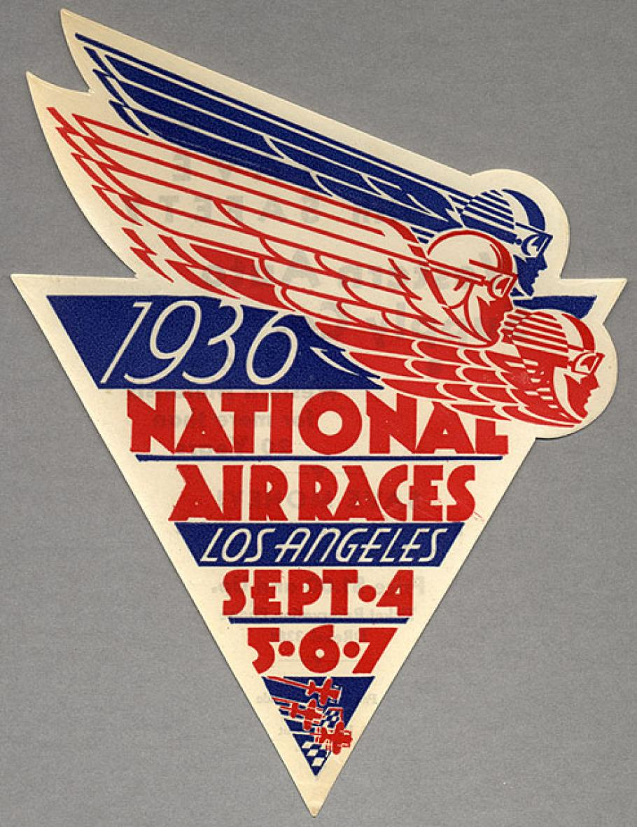 Small sticker in red and blue. Shaped like a triangle and includes the text 1936 National Air Races Los Angles Sept. 4, 5, 6, and 7.