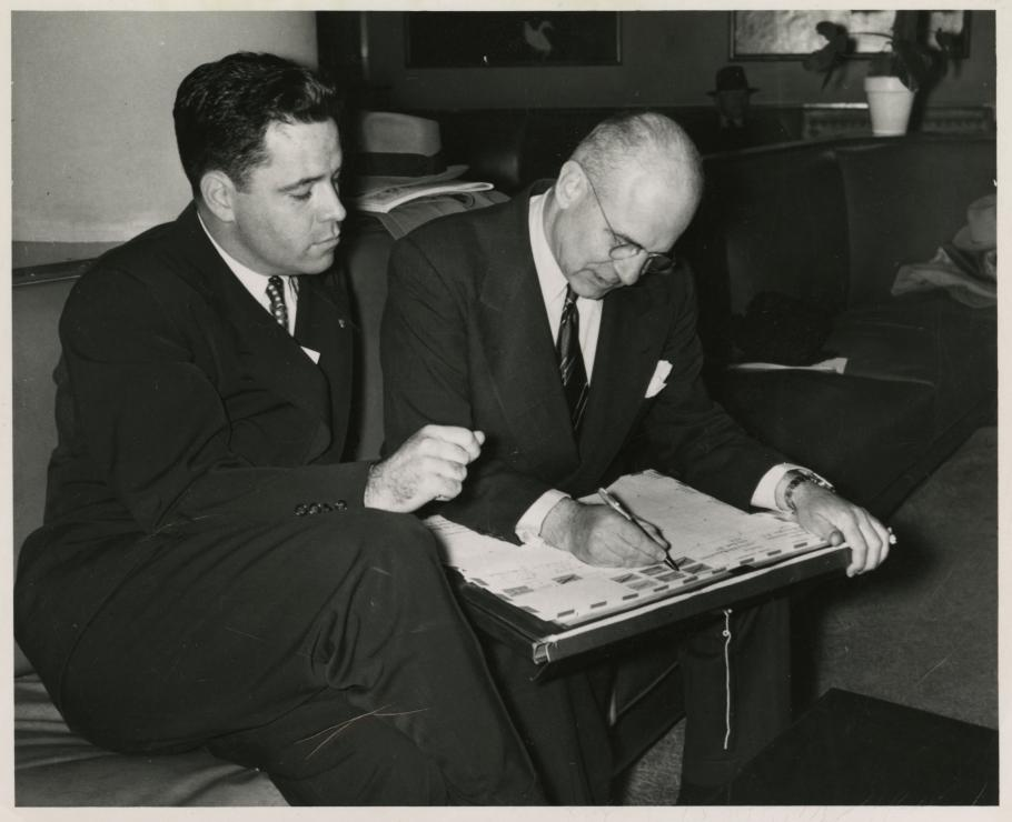 Jimmy Doolittle Signs the 1949 Around the World Envelope while Lanphier watches