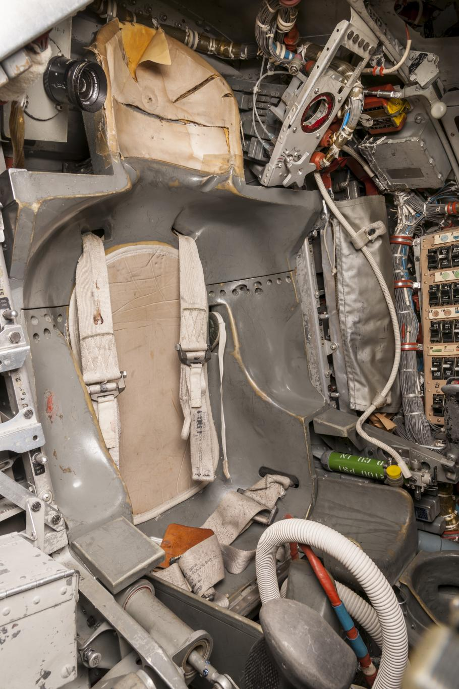 Interior of the capsule with astronaut seat visible.