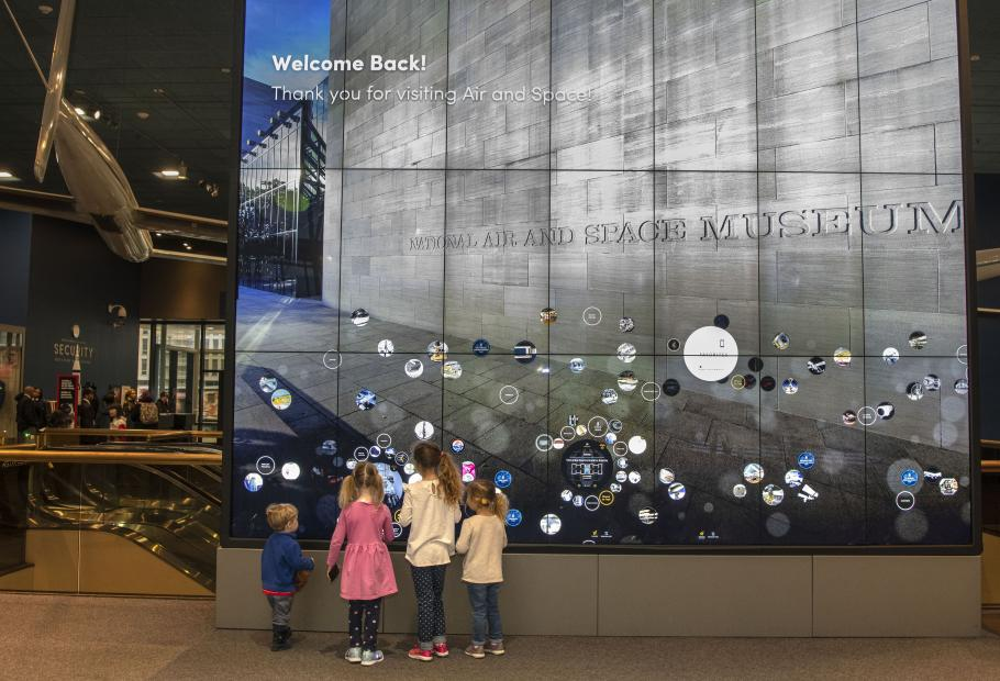Children try out an interactive display in the Boeing Milestones of Flight Hall