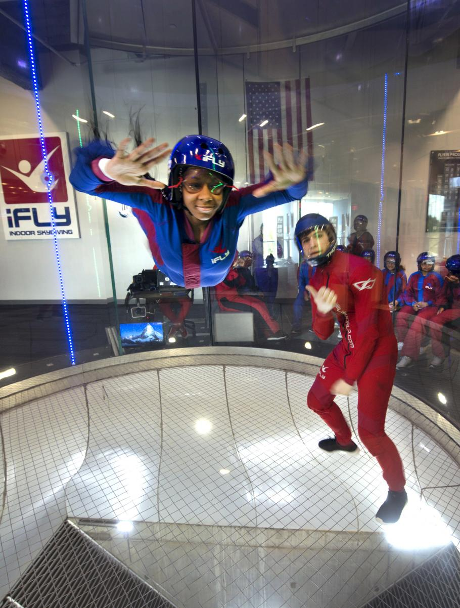 """A student attending the """"She Can"""" STEM camp goes indoor skydiving on a field trip toiFly in Ashburn, Virginia."""