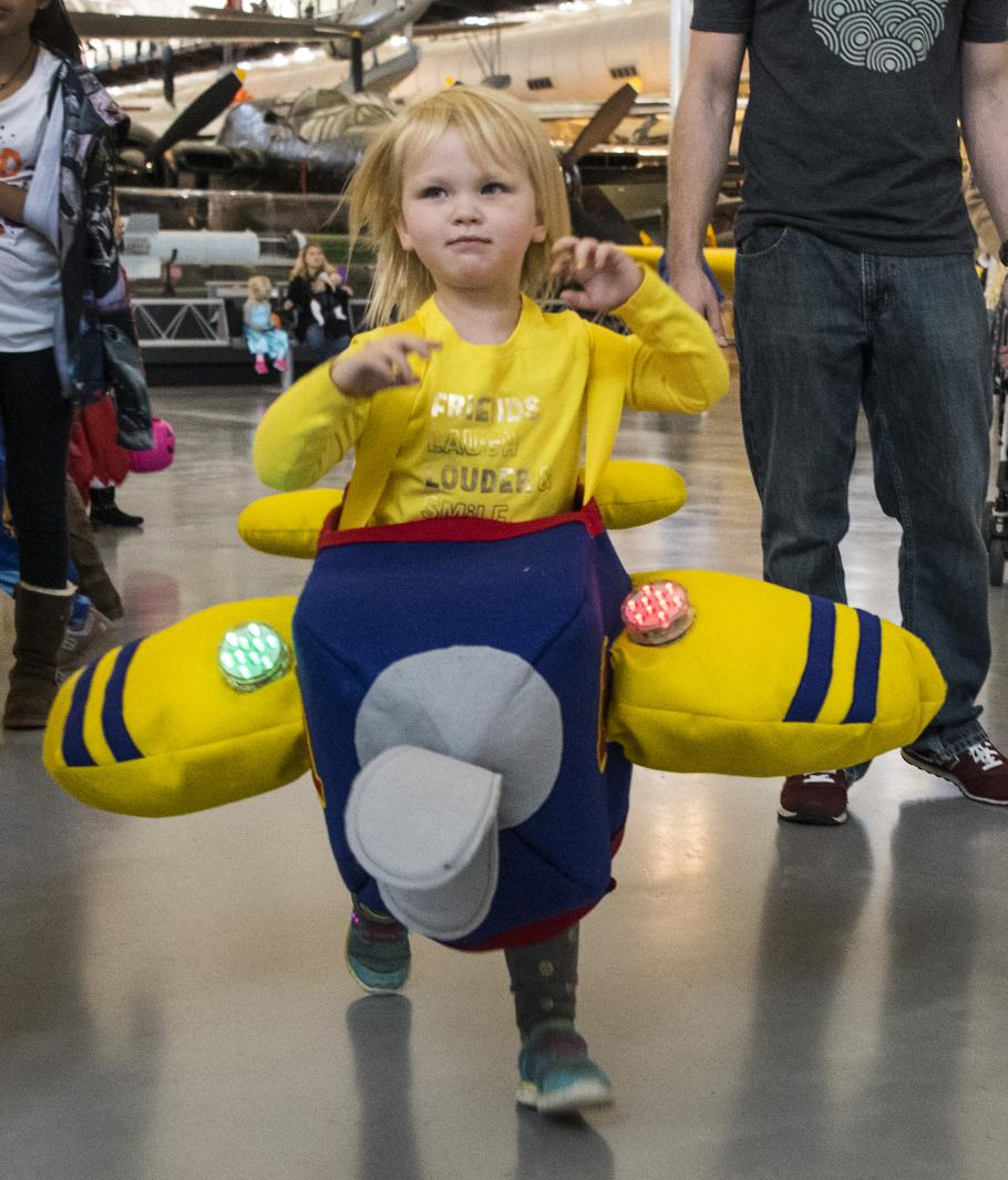 Girl dressed in an airplane costume