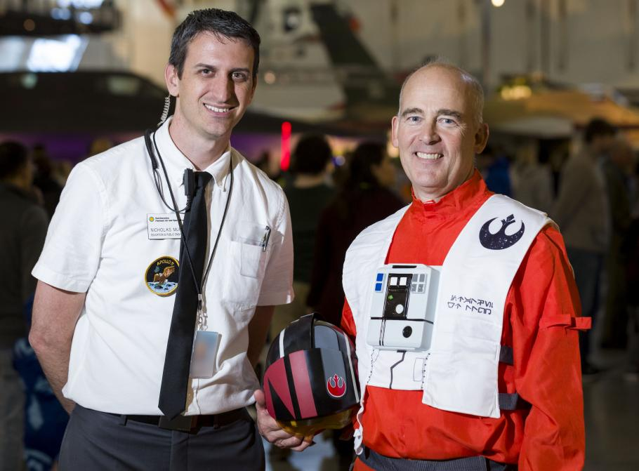 Man wearing Apollo 11 mission control costume and man wearing Star Wars costume
